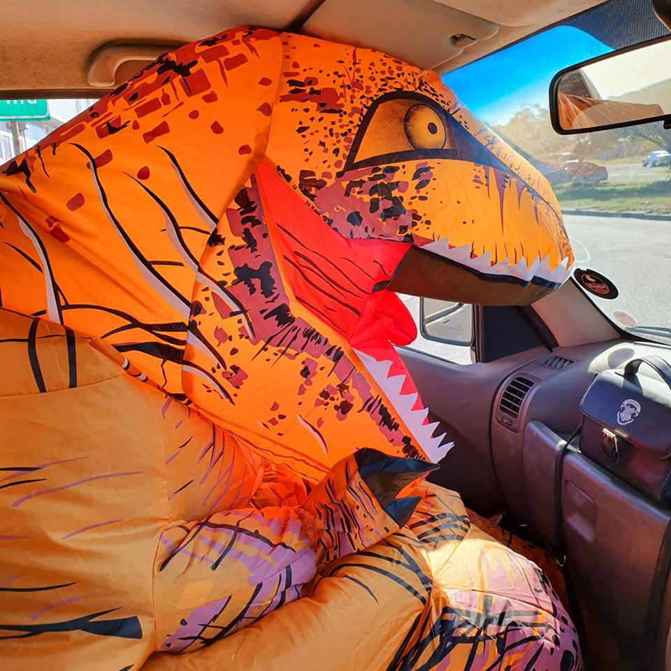 Coronasaurus in a car